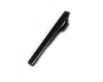 Black tie bar
