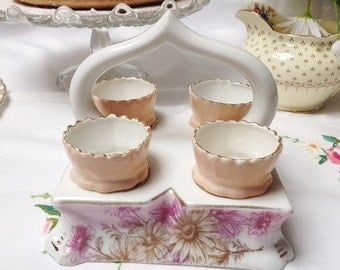 Early German eggcup handled tray/ stand: four egg cups sit in their own handled tray. Beautiful and stylish