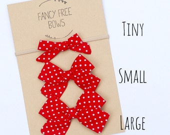 Red White polka dot fabric bow// baby girl// toddler girl// nylon headband or alligator clip
