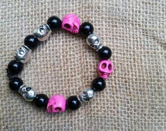 Hot pink and silver skull bracelet.