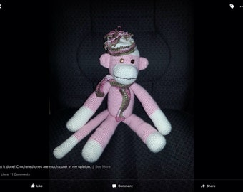 Amigurumi crocheted pink monkey