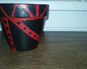 black  & red triangles w/ dots