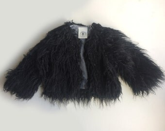 The Jagger Jacket - handmade black shaggy fur swing coat lined with black and white striped fabric