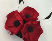 Black and red poppy fascinator