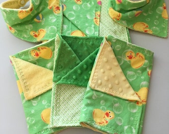 Baby soft flannel blanket with matching bandana bibs and burp cloths