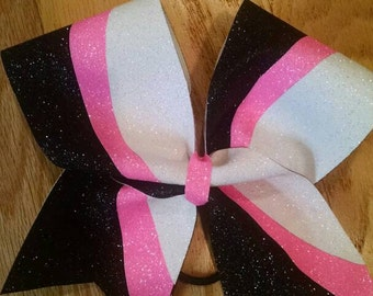 Black, pink, and white kick Swish bow