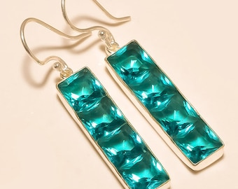 Sterling silver earrings with blue topaz glass