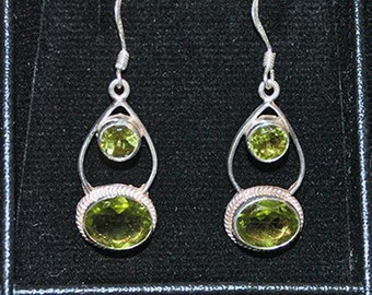 Silver earrings with peridot settings