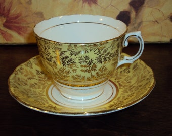 Vintage Yellow Colclough Tea Cup and Saucer with Gold Accenting