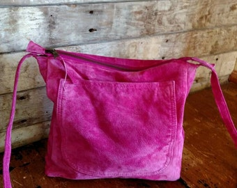 Hot pink Suede leather cross body handbag.