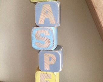 rustic wooden letter blocks