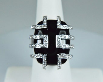 Diamond wrapped onyx ring in 18k white gold