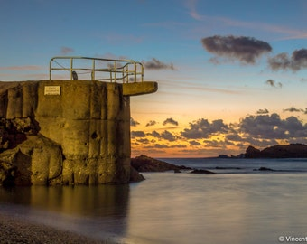 The diving board. Color photograph of the diving board of the old Port in Biarritz beach at sunset. Fine art photography