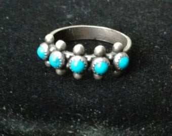 Little blue stones in sterling silver ring size 6.