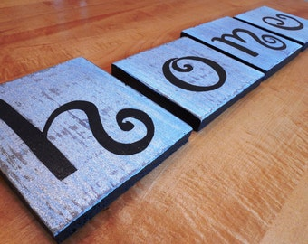 hand lettered reclaimed wood sign