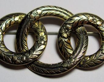 Victorian Interlocking Embossed Circles Floral & Foliate Design Brass Brooch Pin
