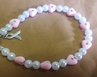 Simply cute, breast cancer awareness bracelet with ribbon charm.