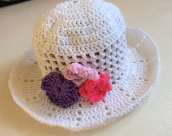 Handmade crocheted white sun hat with flowers, for a baby girl