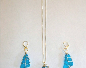 """Beautiful shade of blue (Sea glass) necklace on 24"""" silver chain."""