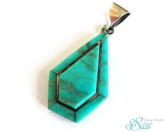 Native American Indian geometric silver and turquoise pendant