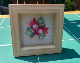 Boxed picture frame with pink white and blue flower bunch