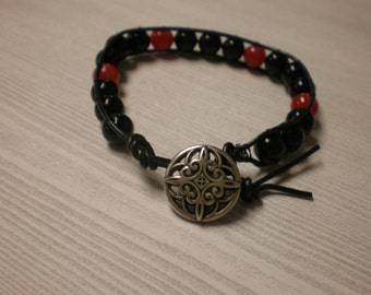 Beaded leather bohemian handmade single wrap bracelet with black & red beads, black leather, and metal button