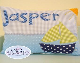 Snuggle pillows with ship, Sun & name