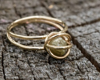 cage ring with yellow raw floating diamond