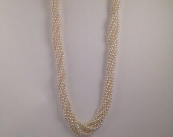 Multi-strand fake pearl