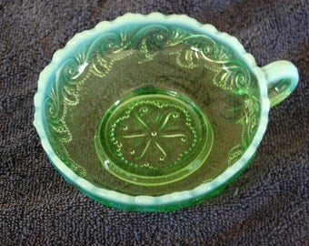 Opalescent Nappy Bowl; Jefferson Glass Co; Sea Spray pattern; Vaseline green; Early 1900's; Glows in a black light; Excellent conditon