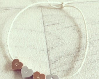 Personalised silver and gold plated heart string