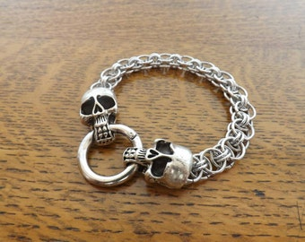 Helm's weave chainmail bracelet with skull clasp fastening.