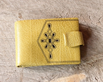 womens vintage wallet in pebble green leather with art deco cutout design, 60s 70s wallet