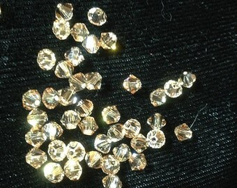 One Gross Swarovksi 4mm Crystal Bicones, Crystal Golden Shadow
