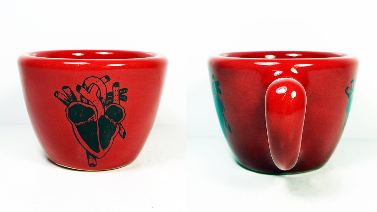 12oz cup shown in Berry Red glaze, featuring an anatomical heart slice print. Made to Order/ Pick Your Colour