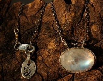 Stunning oval moonstone pendant in silver bezel setting with oxidized silver chain
