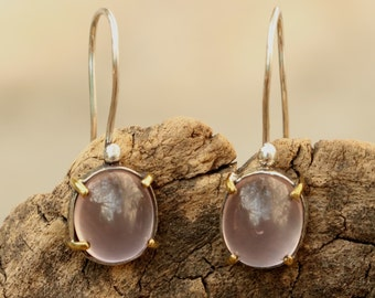 Rose quartz cabochon earrings in silver setting with brass accent prongs
