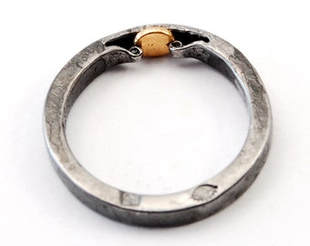"""Ain't None of Your Business"""" ring - iron, 18K gold"""