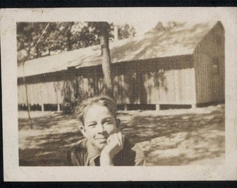 vintage photo Young Teen Boy Leans on Arm Looks into Camera