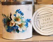 vintage tea tin upcycled shabby chic white blue flowers metal repurposed salvaged cottage kitchen chase and sanborns teas are also delicious