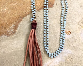 Leather tassel necklace on a blue and brown crystal chain