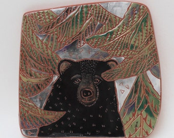 bear on the trail hand carved ceramic art tile
