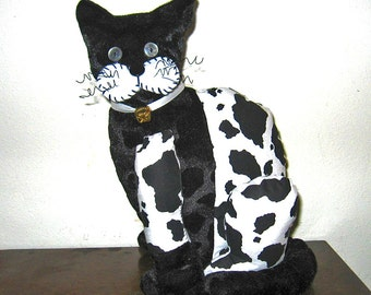Black and White Spotted Stuffed Animal Cat