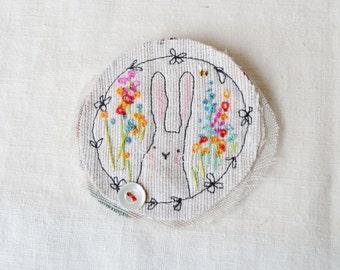 BROOCH Textile - free machine and hand embroidered.  Bunny in the garden.