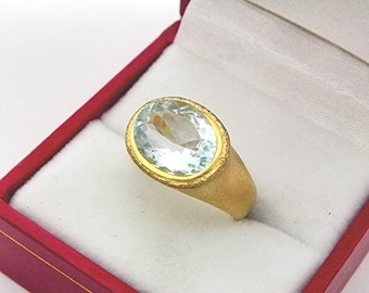 AAA Light Green Aquamarine Top Color   11x9mm  2.88 Carats   in Ladies 18K Yellow gold cocktail ring 10 grams. 2648