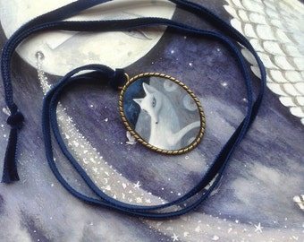 White fox pendant necklace.