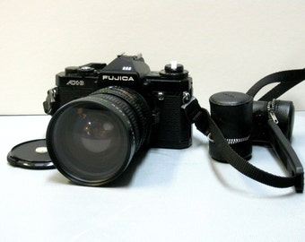 Vintage Black Fujica AX-3 35mm Film Camera with Lens cap, Strap and Attached Film Roll Holders