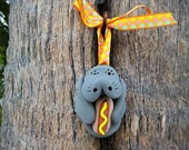 Manatee with Hot Dog Ornament