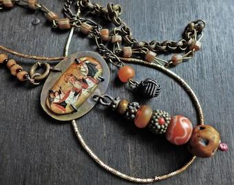 Esemplastic. Rustic choker necklace in earthy pale orange.