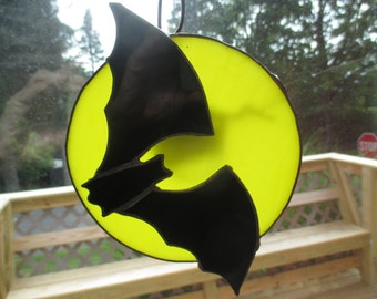 Stained Glass bat flying over the moom